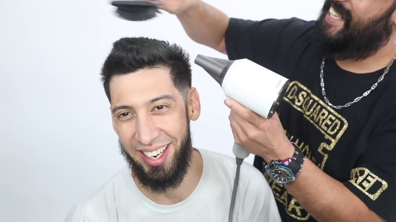 Mid to low Fade Haircut Tutorial featuring Johnee Livingston