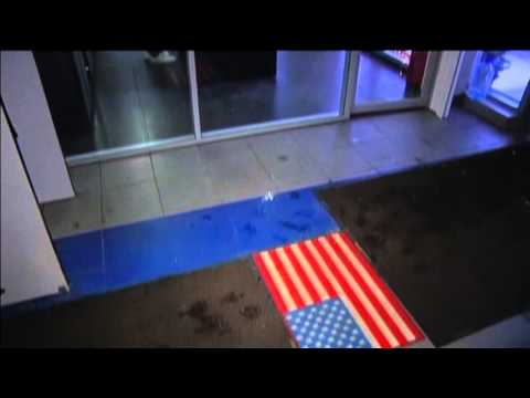Moscow Shoppers Wipe Feet on US Flag: Many Russians see Ukraine war sanctions as US plot