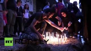 Lebanon: Mourners hold candle-lit vigil for Beirut bombing victims