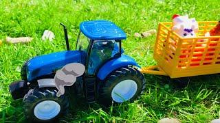 Синий трактор едет на ферму | большой кран | трактор везет животных в прицепе