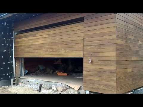 Facade Flush Garage Door Cladded With Oak Planks