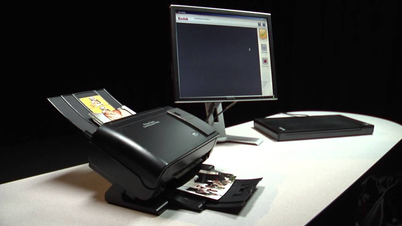 Feeding 4x6 Inch Photos Into The Kodak Picture Saver Scanning System