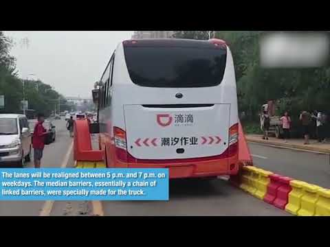 "China-made ""zipper truck"" runs to ease urban traffic jam in east China"