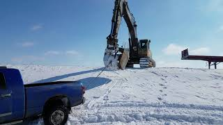 Dodge truck Stuck in the snow excavator pulls it out