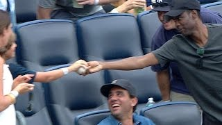 Rock secures foul ball, gives it to a kid