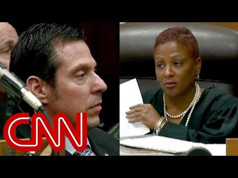Judge confronts 'racist' ex-cop over beating