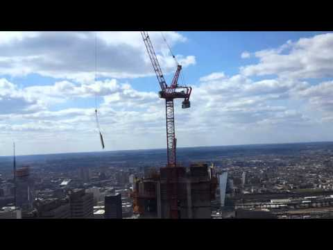 Crane attached to the new Comcast Innovation Tower swinging in the heavy winds.