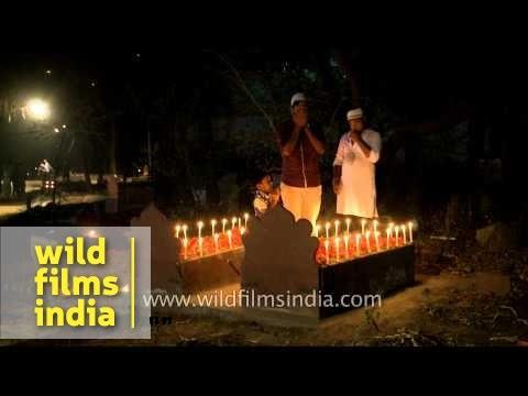 Muslim boy putting incense sticks on his relative's grave - Shab-e-barat