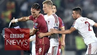 Serbia Albania match abandoned after drone sparks clashes - BBC News