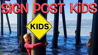 Sign Post Kids have fun at the beach!