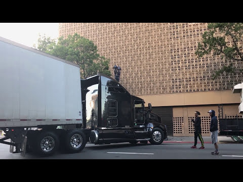 Backing up 18 wheeler in downtown San Diego CA