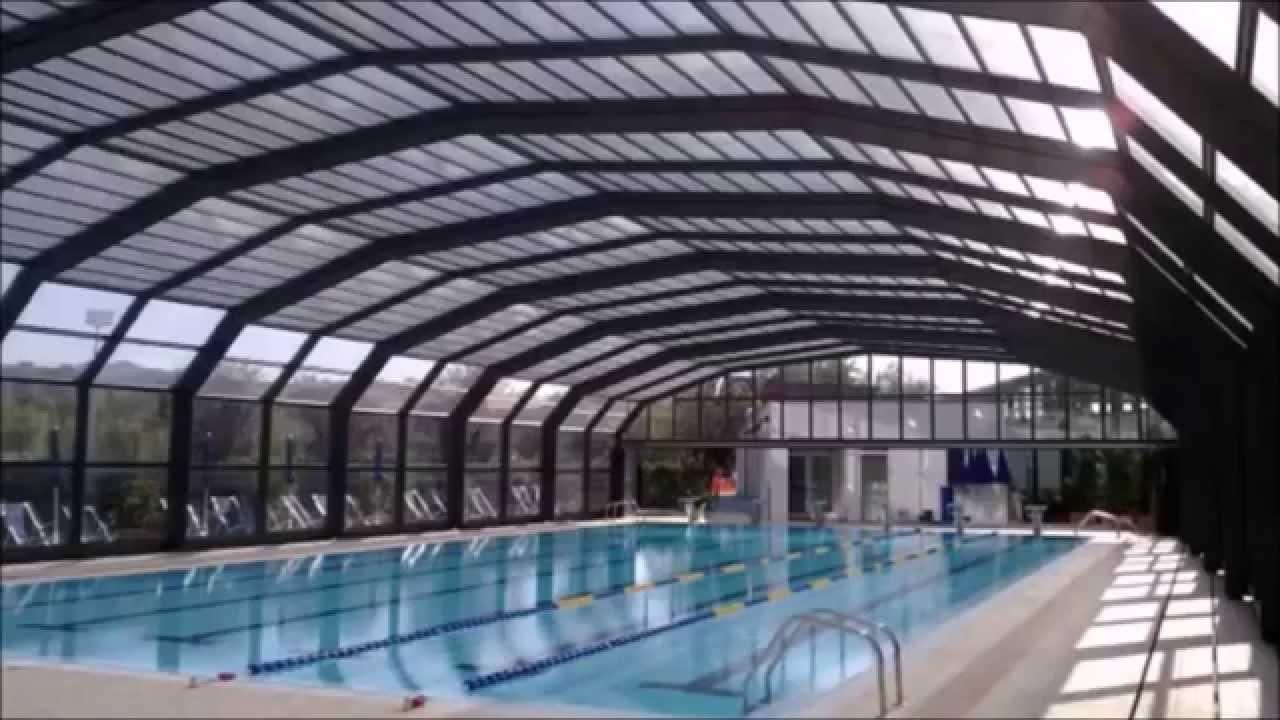 Helianthus coperture telescopiche grandi per piscine pubbliche e centri sportivi youtube - Coperture mobili per piscine ...