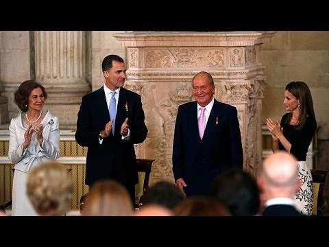 King Juan Carlos signs into law his abdication