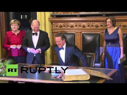Germany: Merkel heckled on arrival to Hamburg City Hall with PM Cameron