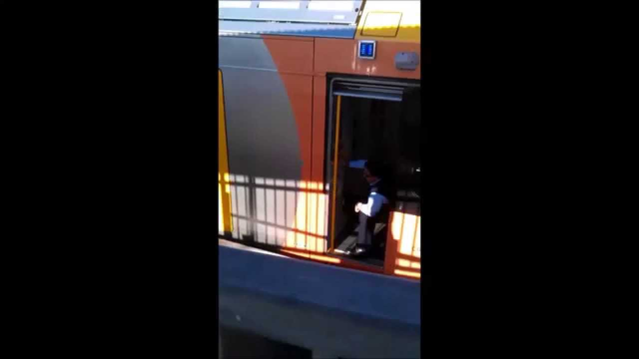 Sydney Trains Guard Seated While Operating Train Door