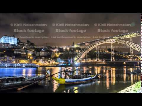 Porto, Portugal old town skyline on the Douro River with rabelo boats timelapse hyperlapse