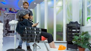 Young girl getting her hair treatment and pedicure by a professional at a salon