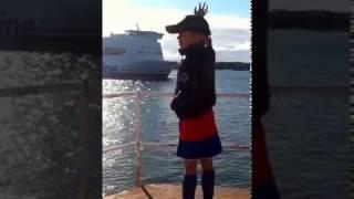 Boy honks at ship