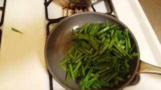 Cooking garlic chives, one of my fave dishes