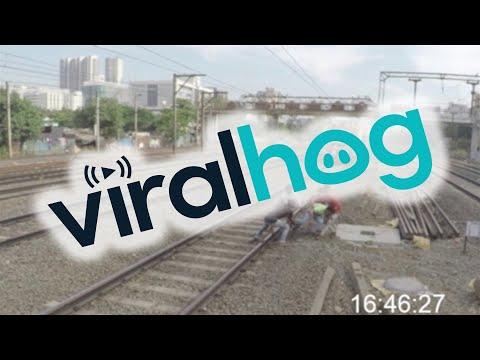 Friends Save Man with Foot Stuck in Train Tracks    ViralHog
