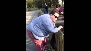 Climbing over a park fence Thumbnail