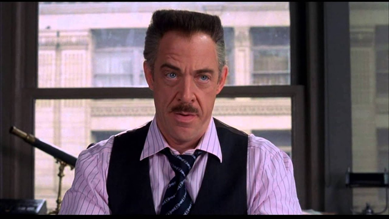 j. jonah jameson looking at spider-man photos (extended scene