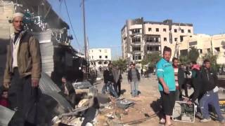 وكالة قاسيون شاهد حجم الدمار الذي خلفته الغارات الجوية على سوق كفر بطنا بريف دمشق 4-12-2015