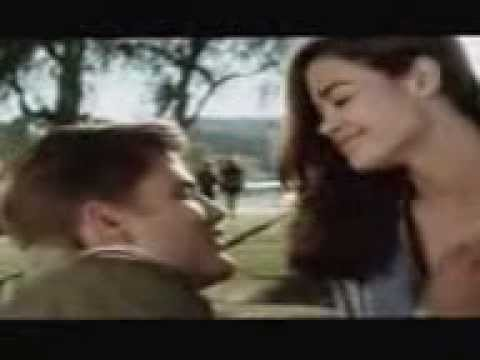 denise richards kissing a guy and having him reach down her high HOT