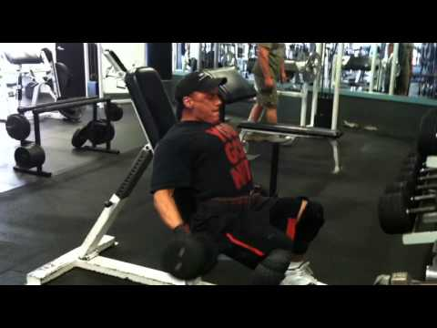 Marc Nadeau performing db incline curls for biceps.