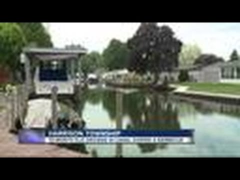 Toddler drowns after falling into canal behind metro Detroit home