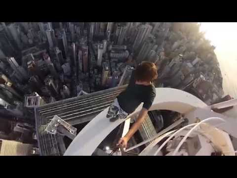 Russian teenagers dangling at the top of a Hong Kong skyscraper