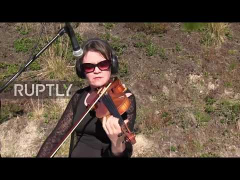 Finland: Beethoven's Ode to Joy played by pistol firing musician