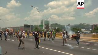 Venezuelan opposition supporters clash with police