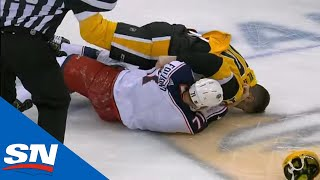 garrett-wilson-bloodied-after-faceplanting-into-ice-following-fight-with-nick-foligno