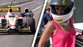 Playmate rides in F1 car with Mario Andretti