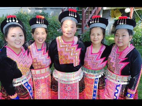 how to make hmong black hat with red pom poms and beads.