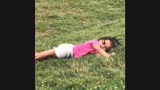 Toddler doesn't know how roll down the hill