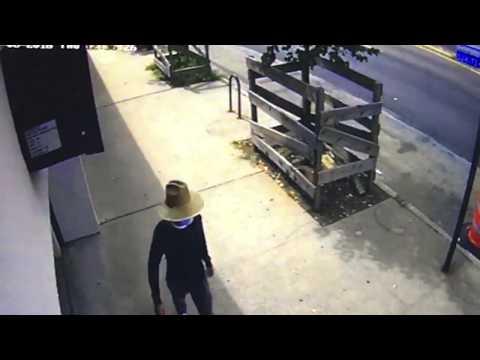 Watch: Man in straw hat, surgical mask sought in bank heist walks down Hylan