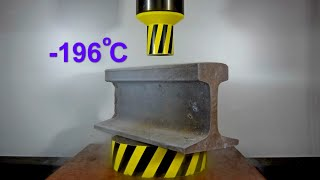 HYDRAULIC PRESS AGAINST RAILWAY RAIL FROZEN IN LIQUID NITROGEN