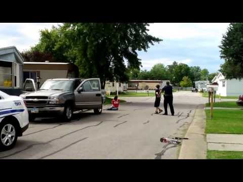 Washington Township Ohio Police Officer Puts Family Face Down in Street with Taser Gun