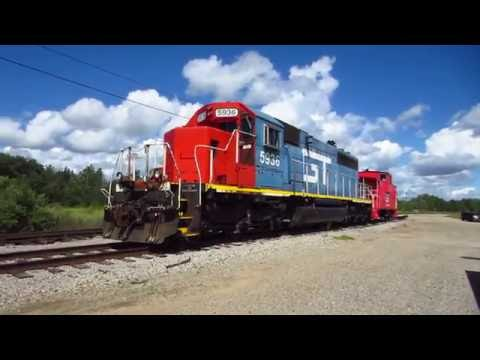 Rolling by the Grand Trunk Western SD40-2 and caboose