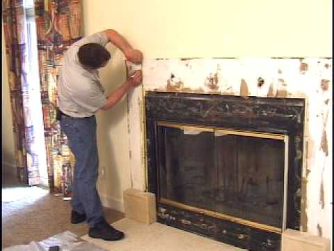 Removal of a old fireplace mantel and replacement with a custom fireplace mantel built by Aplus
