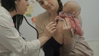 Female Pediatrician Doctor Examining Newborn Baby | Stock Footage - Videohive