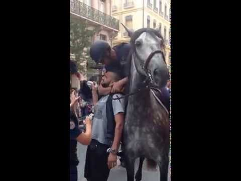 French mounted police arrest motorcycle passenger