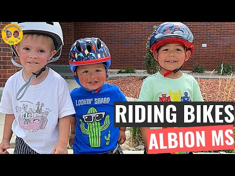 Uly And B Riding Down Balance Bike Ramps At Albion Middle School