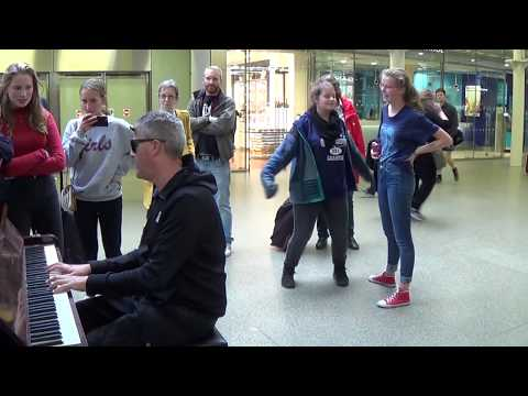 Actor On The Way To Theatre Approaches A Street Piano