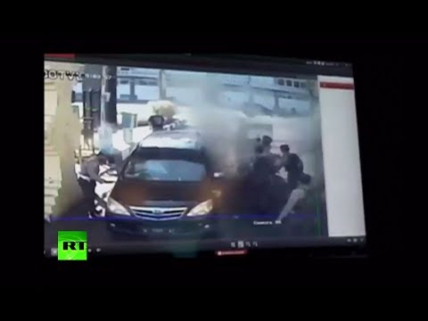 Caught on CCTV: Moment explosion hits police station in Surabaya, Indonesia