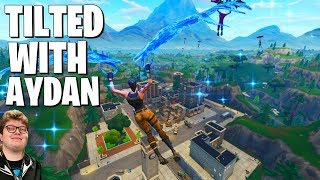 Dropping Tilted Towers with Ghost Aydan