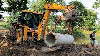 JCB Lifting Heavy Culvert Pipe and Installing in Drain - JCB Dozer Video