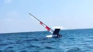 Gabbe capsizing his Catamaran